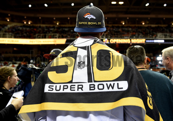 01 February 2016: A Broncos player wears a towel with the Super Bowl 50 logo as a cape during the Denver Broncos portion of Super Bowl 50 Opening Night at SAP Center in San Jose, CA.