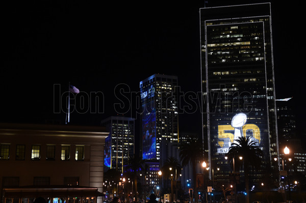 02 February 2016: The Super Bowl 50 logo is projected on the side of two buildings across the street from a waving American flag on The Embarcadero as part of the Super Bowl 50 preview in San Francisco, CA.  (Photo by Chris Williams/Icon Sportswire)