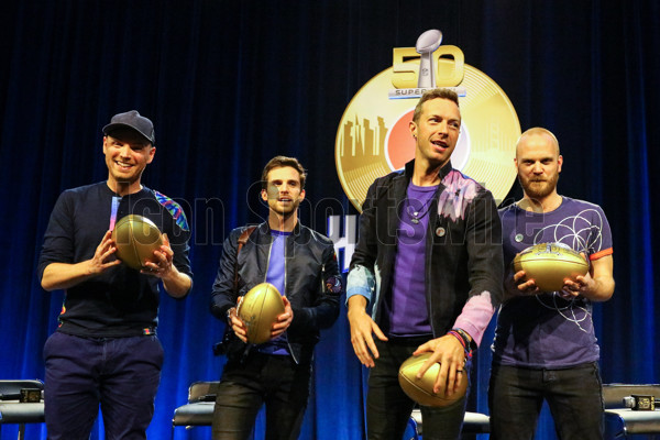 04 FEB 2016: ColdPlay Band members from left to right Jonny Buckland, Guy Berryman Chris Martin and Will Champion pose with Gold Super Bowl 50 Footballs at the Super Bowl 50 Halftime Show press conference  at the Moscone Center in San Francisco California.  (Photo by Rich Graessle/Icon Sportswire)