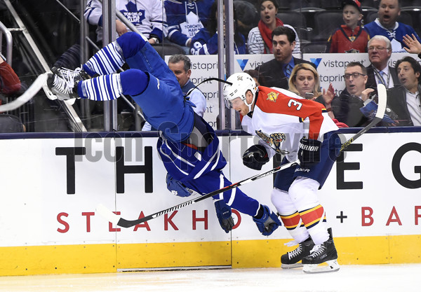 April 4, 2014: Toronto, ON, Canada: Toronto Maple Leafs defenceman Frank Corrado (20) is flipped in the air after a collision with Florida Panthers defenceman Steven Kampfer (3) in the third period at Air Canada Centre. The Panthers won 4-3.  (Photo by Dan Hamilton/Icon Sportswire)