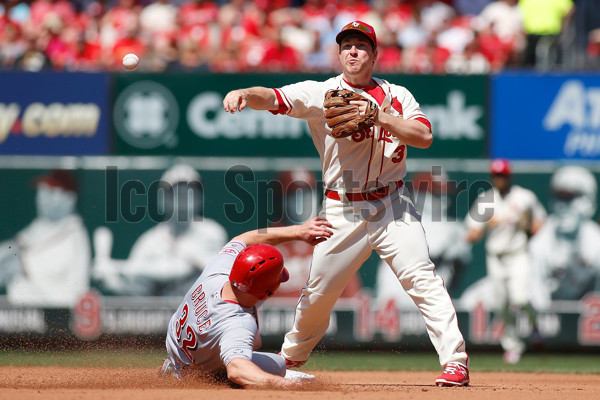 16 APR 2016: St. Louis Cardinals shortstop Jedd Gyorko (3) turns a double play over Cincinnati Reds right fielder Jay Bruce (32) during a baseball game at Busch Stadium in St. Louis Missouri. (Photo by Scott Kane/Icon Sportswire)