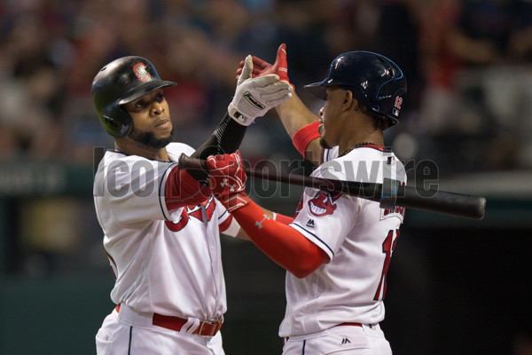 29 July 2016:  Cleveland Indians Designated hitter Carlos Santana (41) [7519] has a fancy handshake with Cleveland Indians Shortstop Francisco Lindor (12) [9119] after hitting a home run during the sixth inning of the Major League Baseball game between the Oakland Athletics and Cleveland Indians at Progressive Field in Cleveland, OH.  Cleveland defeated Oakland 5-3. (Photo by Frank Jansky/Icon Sportswire)