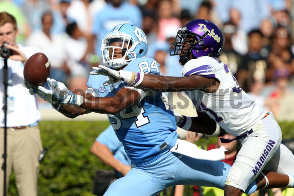 17 September 2016: UNC's Bug Howard (left) catches a 46 yard pass at the end of the first quarter just beyond the reach of JMU's Jimmy Moreland (right). The University of North Carolina Tar Heels hosted the James Madison University Dukes at Kenan Memorial Stadium in Chapel Hill, North Carolina in a 2016 NCAA Division I College Football game. (Photograph by Andy Mead/YCJ/Icon Sportswire)