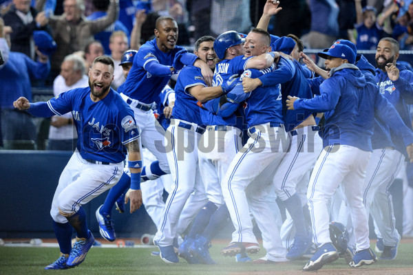 October 9, 2016: Kevin Pillar (11), Josh Donaldson, Troy Tulowitzki (2) and other Toronto Blue Jays players celebrate after winning the MLB ALDS Game 3 against Texas Rangers by a score of 7-6 in the tenth inning at Rogers Centre in Toronto, ON, Canada. (Photograph by Julian Avram/Icon Sportswire)