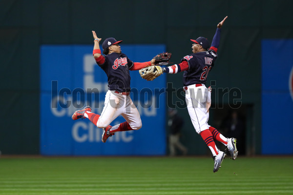 OCT 25, 2016: Cleveland Indians shortstop Francisco Lindor (12) and Cleveland Indians center fielder Rajai Davis (20) celebrate after winning  Game 1 of the 2016 World Series against the Chicago Cubs and the Cleveland Indians at Progressive Field in Cleveland, OH. The Indians defeated the Cubs 6-0. (Photo by Ian Johnson/Icon Sportswire).