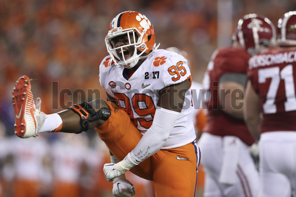 TAMPA, FL - JANUARY 09: Clemson Tigers defensive end Clelin Ferrell (99) celebrates after making a tackle during the 2017 College Football National Championship Game between the Clemson Tigers and Alabama Crimson Tide on January 9, 2017, at Raymond James Stadium in Tampa, FL. (Photo by Mark LoMoglio/Icon Sportswire)