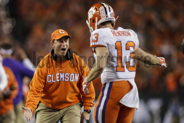 TAMPA, FL - JANUARY 09: Clemson Tigers head coach Dabo Swinney congratulates Clemson Tigers wide receiver Hunter Renfrow (13) after a touchdown during the College Football Playoff National Championship game between the Alabama Crimson Tide and the Clemson Tigers on January 9, 2017, at Raymond James Stadium in Tampa, FL. (Photo by David Rosenblum/Icon Sportswire)
