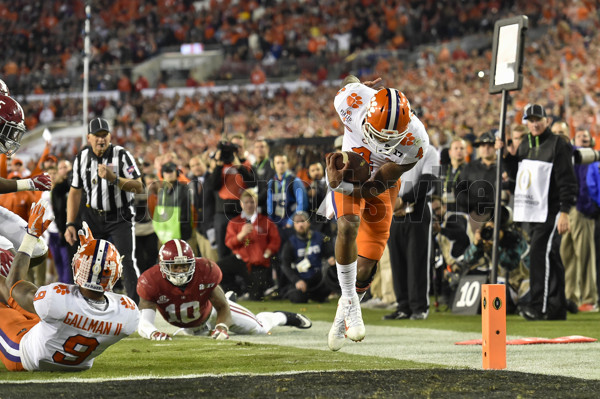 TAMPA, FL - JANUARY 09: Clemson University quarterback Deshaun Watson (4) runs in for a 8 yard touchdown during the first half of the CFP National Championship game between the Alabama Crimson Tide and the Clemson Tigers on January 09, 2017, at Raymond James Stadium in Tampa, FL. (Photo by Roy K. Miller/Icon Sportswire)