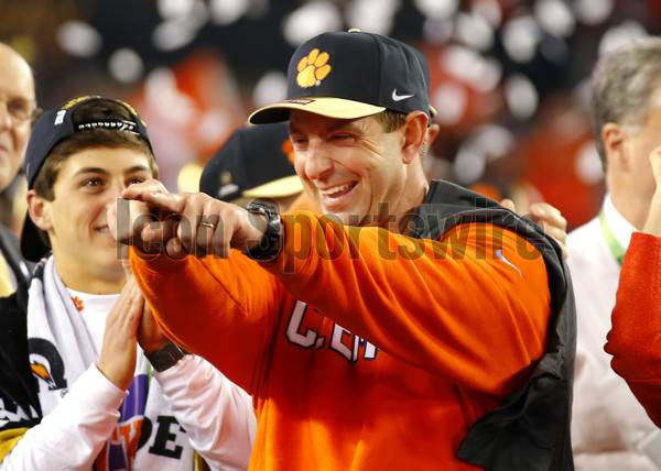 TAMPA, FL - JANUARY 09: Clemson Tigers head coach Dabo Swinney reacts at the trophy presentation at the conclusion of the National Championship game between the Alabama Crimson Tide and Clemson Tigers on January 9, 2017, at Raymond James Stadium in Tampa, FL. Clemson beat Alabama 35-31. (Photo by Todd Kirkland/Icon Sportswire)