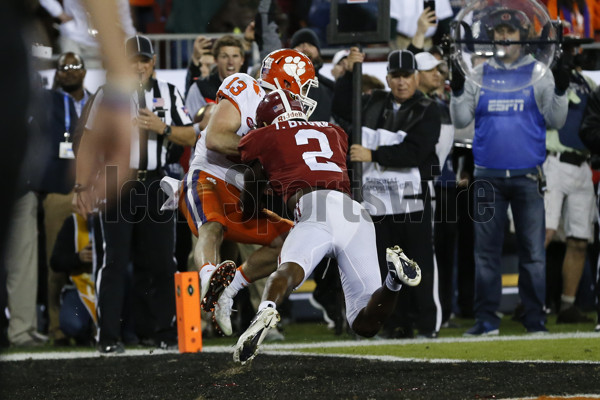 TAMPA, FL - JANUARY 09: Clemson Tigers wide receiver Hunter Renfrow (13) holds onto the ball well being hit by Alabama Crimson Tide defensive back Tony Brown (2) for a touchdown with 1 second left in the 4th quarter of the 2017 College Football National Championship Game between the Clemson Tigers and Alabama Crimson Tide on January 9, 2017, at Raymond James Stadium in Tampa, FL. Clemson defeated Alabama 35-31. (Photo by Mark LoMoglio/Icon Sportswire)