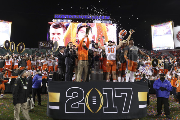 TAMPA, FL - JANUARY 09: Clemson Tigers head coach Dabo Swinney holds up the National Championship trophy after the 2017 College Football National Championship Game between the Clemson Tigers and Alabama Crimson Tide on January 9, 2017, at Raymond James Stadium in Tampa, FL. Clemson defeated Alabama 35-31. (Photo by Mark LoMoglio/Icon Sportswire)