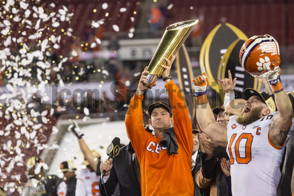 TAMPA, FL - JANUARY 09: Clemson Tigers head coach Dabo Swinney and Clemson Tigers linebacker Ben Boulware (10) celebrate the win after the College Football Playoff National Championship game between the Alabama Crimson Tide and the Clemson Tigers on January 9, 2017, at Raymond James Stadium in Tampa, FL. Clemson won the game 35-31. (Photo by David Rosenblum/Icon Sportswire)
