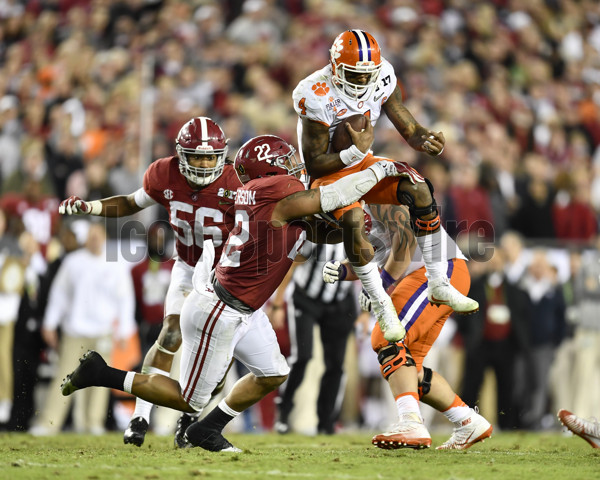 TAMPA, FL - JANUARY 09: Clemson University quarterback Deshaun Watson (4) is wrapped up by University of Alabama linebacker Ryan Anderson (22) during second half of the CFP National Championship game between the Alabama Crimson Tide and the Clemson Tigers on January 09, 2017, at Raymond James Stadium in Tampa, FL. Clemson defeated Alabama 35-31. (Photo by Roy K. Miller/Icon Sportswire)