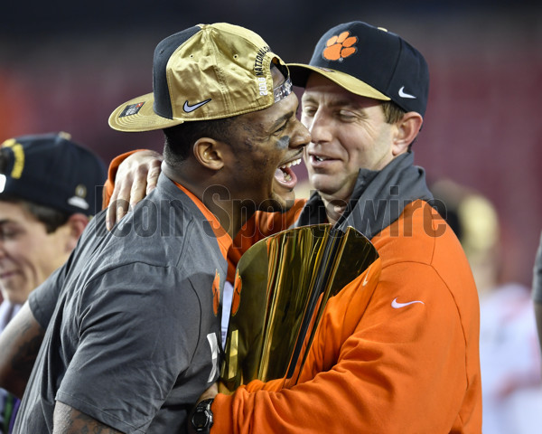 TAMPA, FL - JANUARY 09: Clemson University head coach Dabo Swinney and Clemson University quarterback Deshaun Watson (4) have a laugh during the awards ceremony after the CFP National Championship game between the Alabama Crimson Tide and the Clemson Tigers on January 09, 2017, at Raymond James Stadium in Tampa, FL. Clemson defeated Alabama 35-31. (Photo by Roy K. Miller/Icon Sportswire)