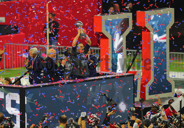 HOUSTON, TX - FEBRUARY 05: New England Patriots Quarterback Tom Brady (12) raises the Vince Lombardi Trophy to celebrate the victory during the New England Patriots 34-28 victory over the Atlanta Falcons in Super Bowl LI on February 5, 2017, at NRG Stadium in Houston, TX. (Photo by Rich Graessle/Icon Sportswire)