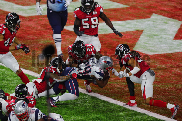 HOUSTON, TX - FEBRUARY 05: New England Patriots Running Back James White (28) scores the winning touchdown on a 2-yard run in overtime during the New England Patriots 34-28 victory over the Atlanta Falcons in Super Bowl LI on February 5, 2017, at NRG Stadium in Houston, TX. (Photo by Rich Graessle/Icon Sportswire)
