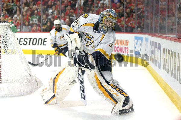 CHICAGO, IL - APRIL 15:  Nashville Predators goalie Pekka Rinne (35) clears a puck in the second period during game 1 of the first round of the 2017 NHL Stanley Cup Playoffs between the Chicago Blackhawks and the Nashville Predators on April 15, 2017, at the United Center in Chicago, IL.  (Photo by Robin Alam/Icon Sportswire)