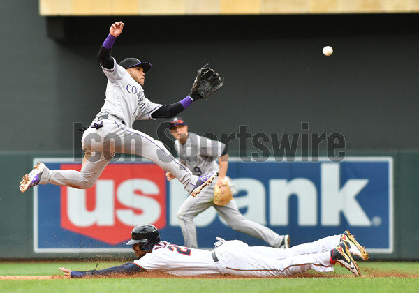 MINNEAPOLIS, MN - MAY 18: Minnesota Twins Center field Byron Buxton (25) steals second as Colorado Rockies Infield Alexi Amarista (2) leaps for an errant throw by Colorado Rockies Catcher Tony Wolters (14) during game 1 of a MLB doubleheader between the Minnesota Twins and Colorado Rockies on May 18, 2017 at Target Field in Minneapolis, MN. The Rockies defeated the Twins 5-1.(Photo by Nick Wosika/Icon Sportswire)