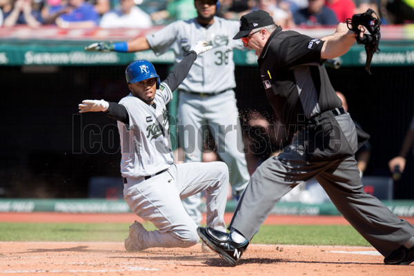 CLEVELAND, OH - MAY 27: Kansas City Royals Shortstop Alcides Escobar (2) is called safe by home plate umpire Tim Welke (3) after he scored on a sacrifice fly during the first inning of the Major League Baseball game between the Kansas City Royals and Cleveland Indians on May 27, 2017, at Progressive Field in Cleveland, OH. (Photo by Frank Jansky/Icon Sportswire)