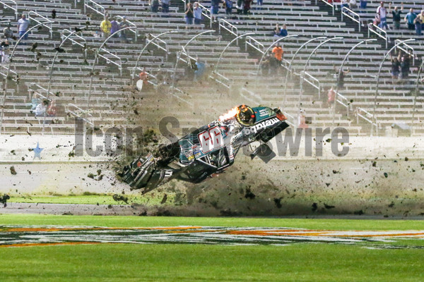 FORT WORTH, TX - JUNE 09: Camping World Truck Series driver Timothy Peters (99) gets in a wreck and flips several times down the front stretch during the 21st Annual Winstaronlinegaming.com 400 on June 09, 2017 at the Texas Motor Speedway in Fort Worth, TX. (Photo by Matthew Pearce/Icon Sportswire)