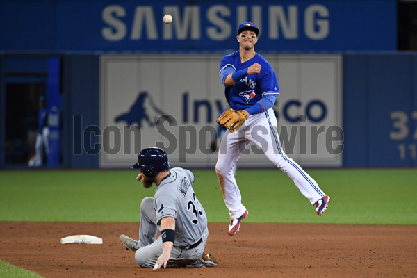 TORONTO, ON - JUNE 13: Toronto Blue Jays Shortstop Troy Tulowitzki (2) turns a double play over Tampa Bay Rays Catcher Derek Norris (33) during the regular season MLB game between the Toronto Blue Jays and Tampa Bay Rays on June 13, 2017 at Rogers Centre in Toronto, ON. (Photo by Gerry Angus/Icon Sportswire)