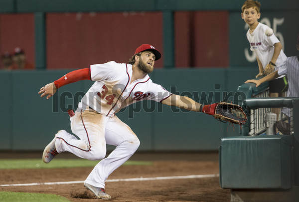 WASHINGTON, DC - JUNE 28: Washington Nationals right fielder Bryce Harper (34) reaches out for the ball deep in the right field in the ninth inning during a MLB game between the Washington Nationals and the Chicago Cubs on June 28, 2017, at Nationals Park, in Washington DC. The Nationals defeated the Cubs 8-4.