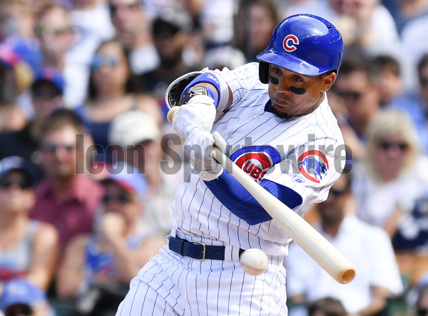 CHICAGO, IL - JULY 22:  Chicago Cubs left fielder Jon Jay (30) hits the ball for a ground out during the game between the St. Louis Cardinals and the Chicago Cubs on July 22, 2017 at Wrigley Field in Chicago, Illinois.  (Photo by Quinn Harris/Icon Sportswire)