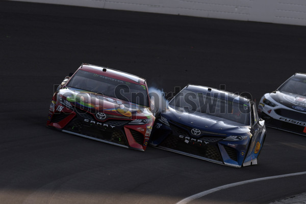 INDIANAPOLIS, IN - JULY 23: Kyle Busch (18) Joe Gibbs Racing (JGR) Toyota Camry and Martin Truex Jr (78) Furniture Row Racing Toyota Camry get together on a late restart during the NASCAR Monster Energy Cup Series Brantley Gilbert Big Machine Brickyard 400 on July 23, 2017, at the Indianapolis Motor Speedway in Indianapolis, Indiana. (Photo by Michael Allio/Icon Sportswire)
