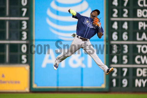 HOUSTON, TX - AUGUST 02: Tampa Bay Rays shortstop Adeiny Hechavarria (11) leaps in the air to make the throw to first base coming up short in the sixth inning of a MLB game between the Houston Astros and the Tampa Bay Rays at Minute Maid Park, Wednesday, August 2, 2017. (Photo by Juan DeLeon/Icon Sportswire)