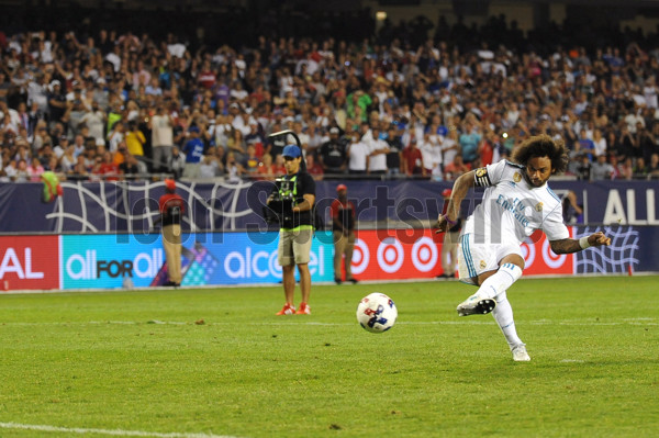 CHICAGO, IL - AUGUST 02: Real Madrid defender Marcelo (12) scores the game winning goal during penalty kicks against the MLS All-Stars during a soccer match on August 2, 2017, at Soldier Field, in Chicago, IL. The game ended in a 1-1 tie with Real Madrid winning on penalty kicks 4-2. (Photo by Patrick Gorski/Icon Sportswire)