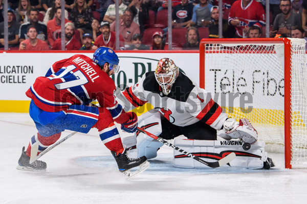 MONTREAL, QC - SEPTEMBER 21: New Jersey Devils goalie Keith Kinkaid (1) makes a pad save against Montreal Canadiens center Torrey Mitchell (17) during the second period of the NHL preseason game between the New Jersey Devils and the Montreal Canadiens on September 21, 2017, at the Bell Centre in Montreal, QC (Photo by Vincent Ethier/Icon Sportswire)